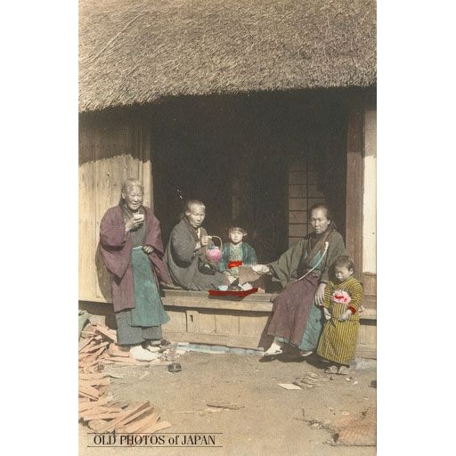"1910's. ""What a wonderful and relaxed scene. Three women and two small kids, all wearing traditional clothing, having a welcome tea break at the engawa of a thatched house. The women's clothing does not seem to be the working wear for these farm women. Perhaps this was a small social gathering of neighbourhood women for tea rather than a break during a day of hard work. Nonetheless, the pile of fire wood seems to imply that these moments of rest were rare."""