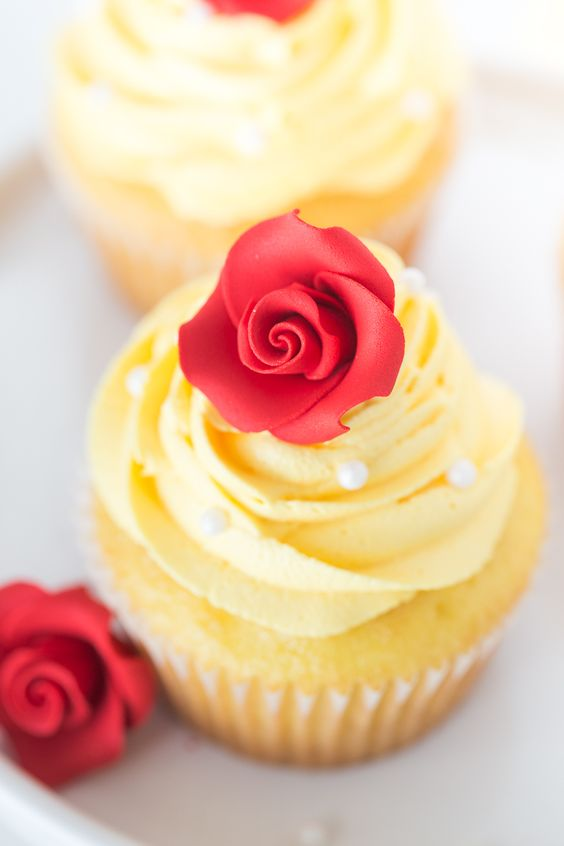 Belle Cupcakes: simple and beautiful cupcakes that are perfect for any Beauty and The Beast Party or princess party! This post contains affiliate links.  As most little girls, my sister and I grew up on all the classic Disney princess movies.  Our personal favorites were Aladdin, The Little Mermaid and Beauty and the Beast.  When …