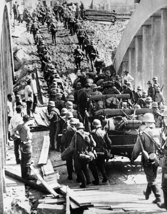8 September 2016	TODAY IN HISTORY [¶] 1939 - Germany Invades Poland - German infantry crossing a hastily repaired bridge in Polish territory which was bombed by the Poles in face of the enemy on September 8.  © AP Photo