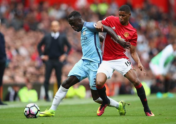 Marcus Rashford of Manchester United in action with Bacary Sagna of Manchester…