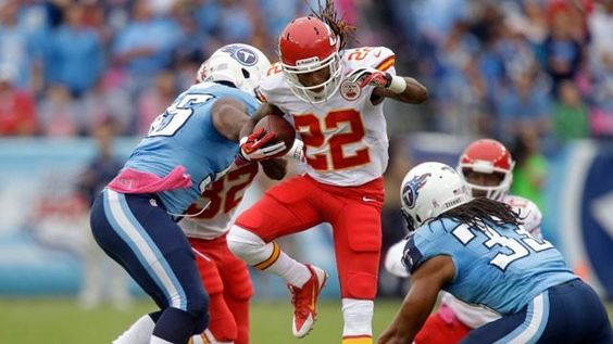 Kansas City Chiefs wide receiver Dexter McCluster (22) runs against Tennessee Titans defenders Michael Griffin (33) and Alterraun Verner (20) in the first quarter of an NFL football game on Sunday, Oct. 6, 2013, in Nashville, Tenn. (AP Photo/Mark Humphrey)