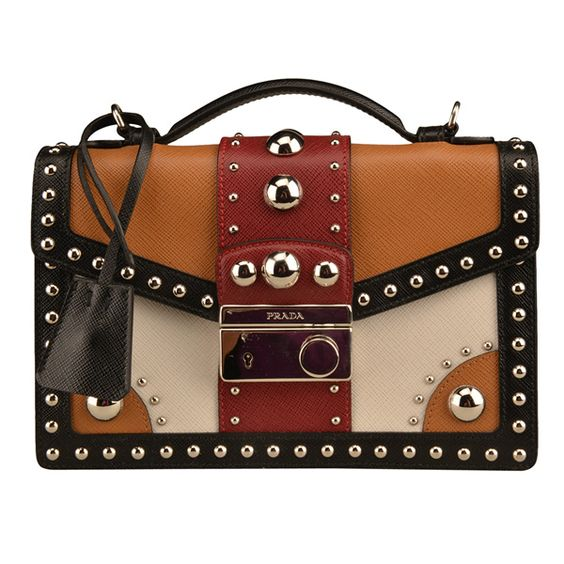 Prada leather and grommet crossbody bag, $1,995, Balliets. View ...