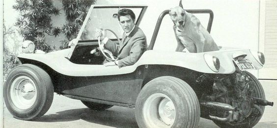 Elvis Presley with his dog in a dune buggy. Taken in 1968.