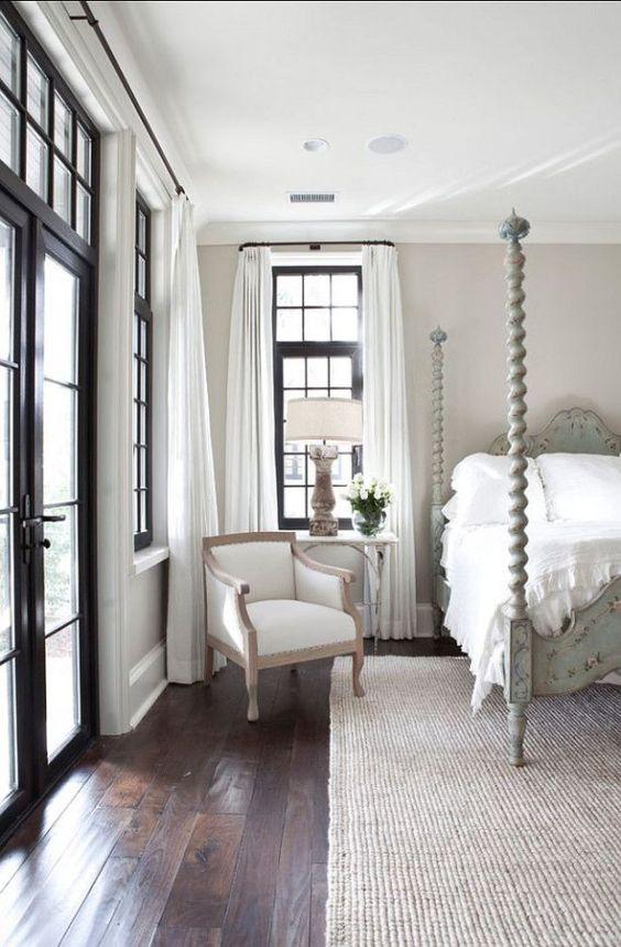 Neutral walls, crisp white sheets and black bedroom doors.