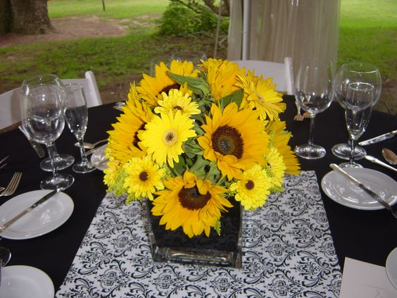 Low centerpieces of viking mus gerber daisies and mini