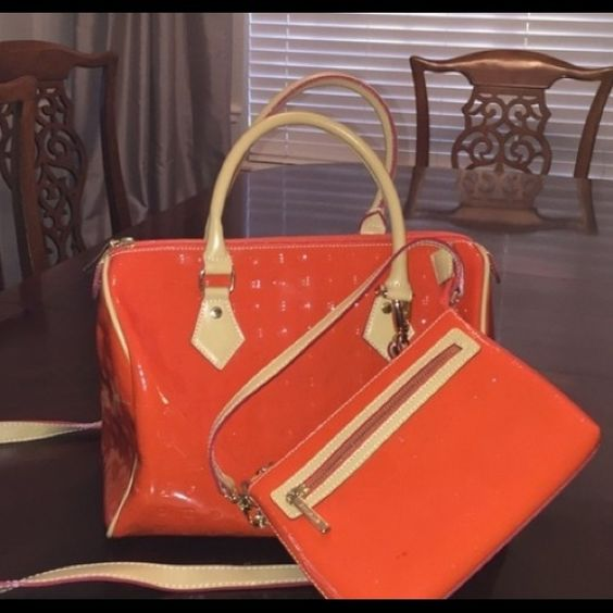 Gorgeous Arcadia Satchel or Shoulder Handbag Gorgeous Arcadia Satchel or Shoulder Handbag in orange/red color. Looks amazing with black and really pops. Made in Italy. No trades please. Arcadia Bags Satchels