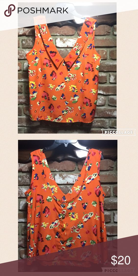 Orange printed button back dress blouse Bought from Kaitlyn. Loose fit blouse type top. Looks great tucked in w black bottoms. Buttons on back are bronze and non-functional Kaitlyn Tops Blouses