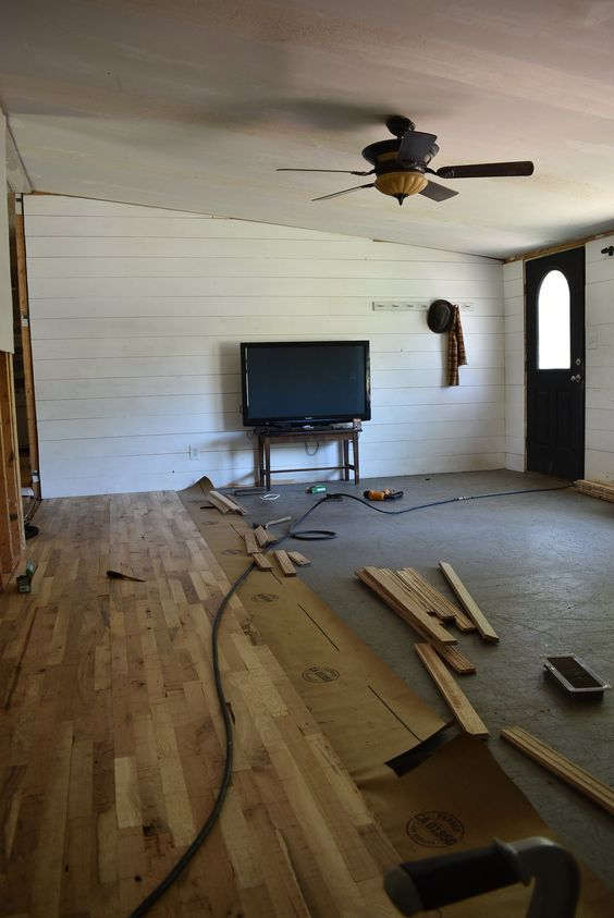 Double Wide Mobile Home Remodel. This family is making over a double wide home on a budget. This is the living room in the double wide that they have added hardwood floors in.