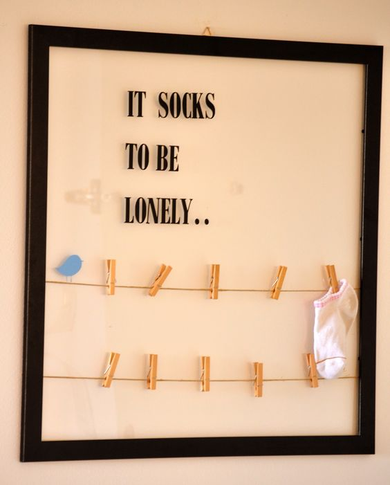 Lost socks frame..cute idea for inside the laundry rm :):