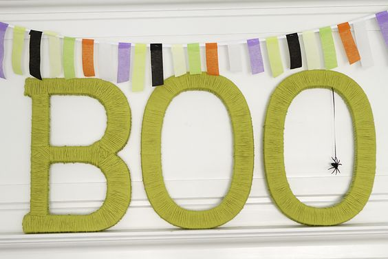 Cover Letters in yarn and then hang spiders from a web. Simple and easy!