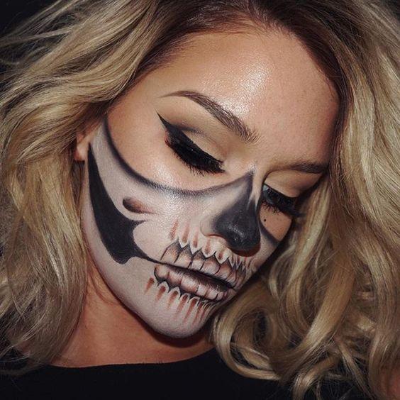 happy halloween half skull makeup inspired by