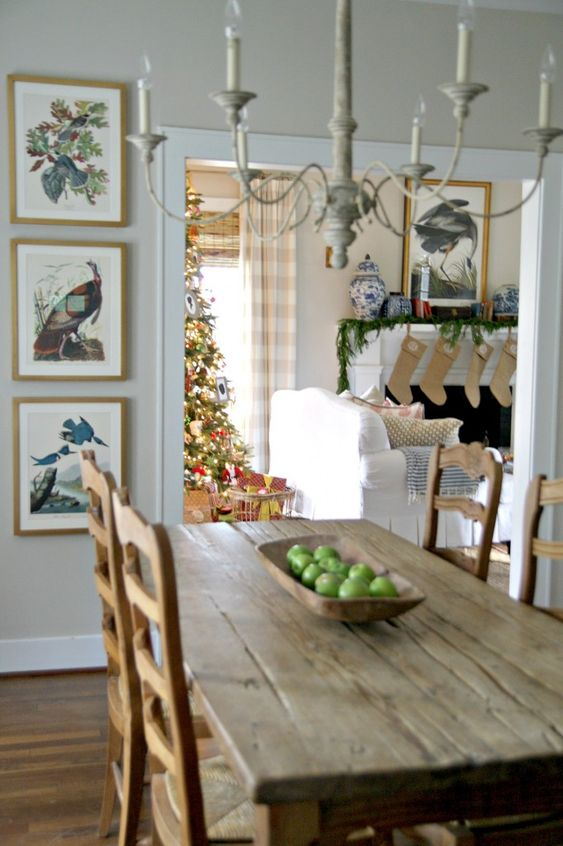Farmhouse dining room with rustic farm table, French chairs, French Country chandelier, and Audubon framed prints. Design by Holly Mathis. #farmhouse #diningroom #holidays #decorating