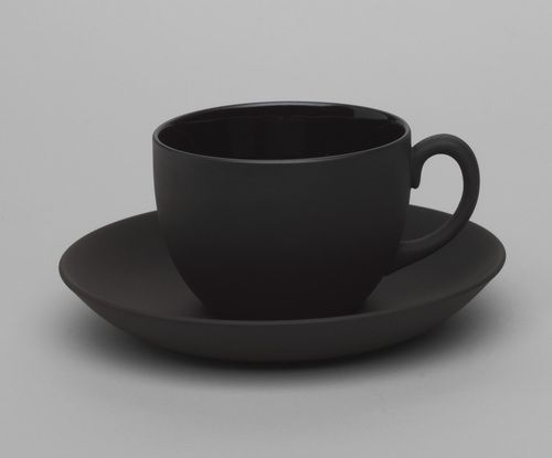 Black Coffee Cups And Saucers The Table