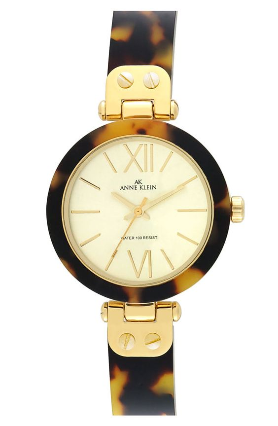 tortoise shell watch. I want one so bad! I love that this one is different.