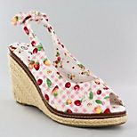 These just scream SUMMER.  Pink Gingham & Cherries wrapped up into a peep-toe slingback espadrille.  I love shoes!