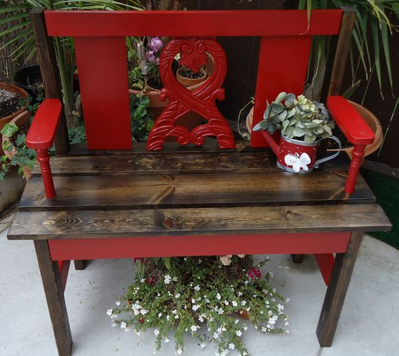 """SOLD - Bench with old chair remnants in """"Barn"""" red."""