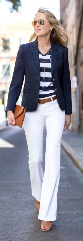 70s fashion revival mid rise high waisted white flare leg jeans, brown braided belt, brown peep toe bootie mules, navy and white wide stripe v-neck burberry t-shirt tee with pocket, navy blazer: