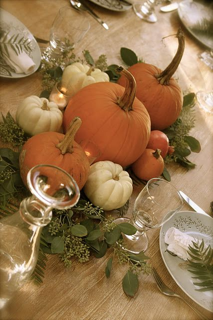 Thanksgiving centerpiece, I would use some gourds as well. Add a little glitter and candles and maybe this will be for my oct wedding.