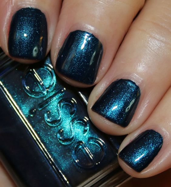 Essie Fall 2015 Collection   Vampy Varnish / Bell-Bottom Blues is a deep indigo blue shimmer