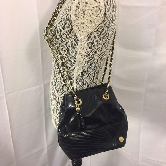 Toledano Black Pleather Purse Gold Chain Strap Great bag! Great shape! Bag Height: 9 inches / Bag Width: 12 inches / Bag Height from Chain to bottom of bag: 27.5 inches / Chain length to bag: 18.5 inches Toledano Bags Crossbody Bags