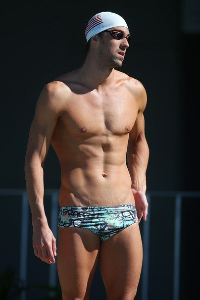 Michael Phelps Photos Photos - Michael Phelps prepares to swim during the Team USA squad training at the Gold Coast Aquatics Centre on August 20, 2014 in Gold Coast, Australia. - USA Pan Pacs Squad Training Session