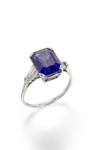 A sapphire and diamond ring, by Boucheron The rectangular step-cut sapphire…