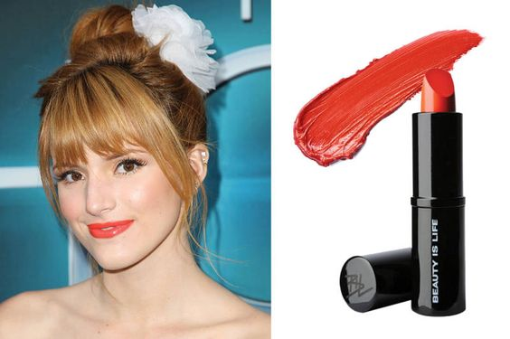 Bella Thorne  Ginger haired girls cannot go wrong with a bright orange lip with pink undertones.   Beauty Is Life Lipstick in Orange, $28; barneys.com