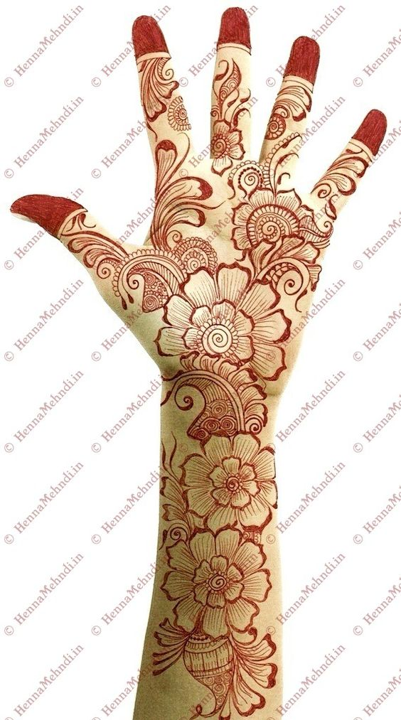 Trend alert: mehndi designs for 2013 use big petal flowers with tiny leaflets (arabic style).