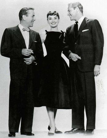 "The little black dress by Hubert de Givenchy that Audrey Hepburn wore in ""Sabrina,"" with Humphrey and William Holden:"