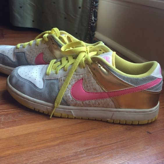 Women's Nikes White and grey nikes with pink, yellow and good detailing. In good condition. 100% authentic. Nike Shoes