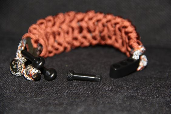 Paracord Survival Bracelet with shakle made from 550 paracord in rust.  Pattern is double virus.   Available in 6, 7 , and 8 inches.  Request size in comments to seller.