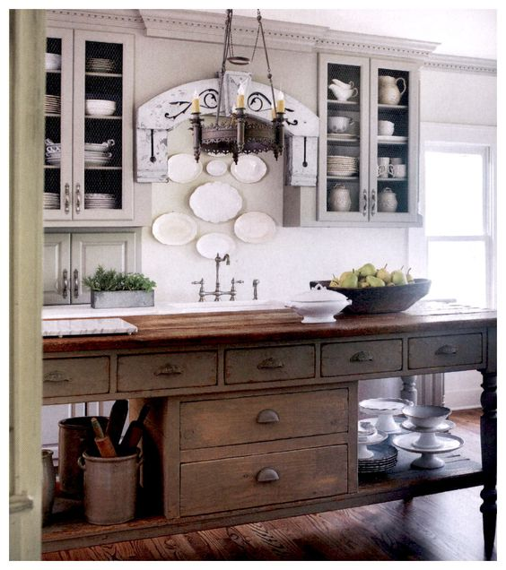 Country Home - Winter 2016. Antique worktable repurposed as an island. False drawer fronts hide a bread warmer.