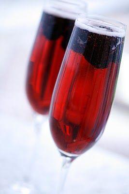 Kir Royale. Champagne + Creme de Cassis + frozen blackberries. Yum!