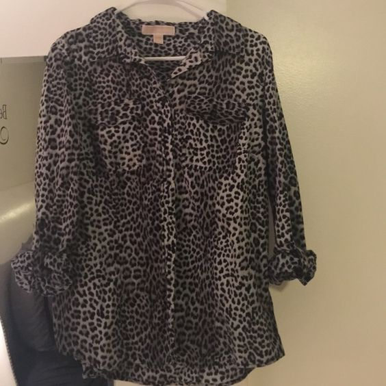 Michael Kors button down Cheetah print MK button down. 3/4 length sleeves that roll up an button. Super cute! MICHAEL Michael Kors Tops