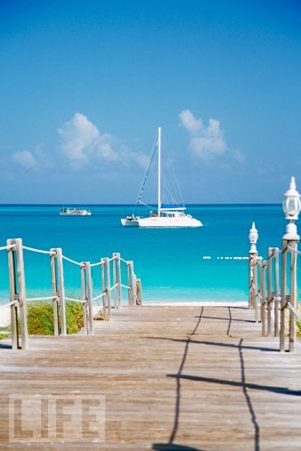 Turks & Caicos Islands  Located just south of the Bahamas, these islands   have unspoiled natural beauty and an average of 350 days of sun each year.>> I do believe adventure does await me here...