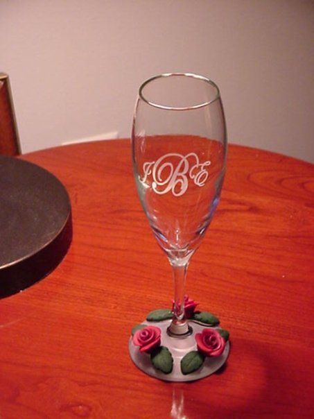 Sandblasted Monogram with polymer clay rose accents.  Made by me.