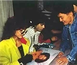 Prince and Sheila E signing autographs