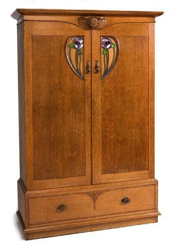 LXF41 Arts and Crafts Glasgow School  wardrobe by John Ednie    An Arts and Crafts Glasgow School wardrobe in oak with stained glass panels and carved angel's head decoration to the cornice.  John Ednie.  Wylie & Lochhead Glasgow.  Circa 1900