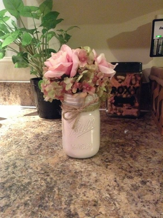lovely wedding table centerpiece idea - painted mason jar with bakers twine and flowers. Who will not love this for a rustic fall wedding?