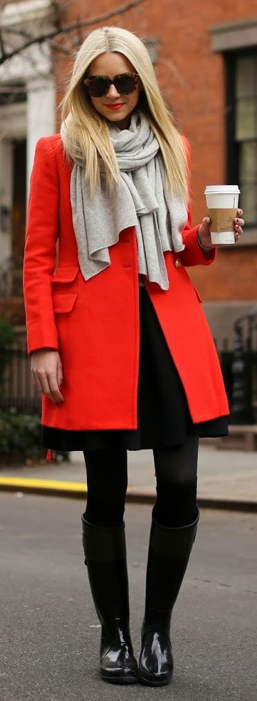 bright coat contrasted against black tights and gray scarf