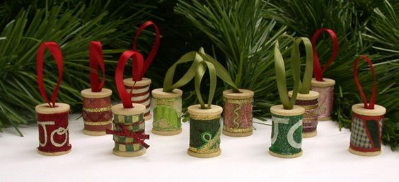 Decorated wooden spool ornaments