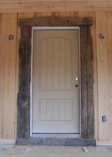 Rustic door trim sun room trimmed with old barn wood for Wood trim around doors