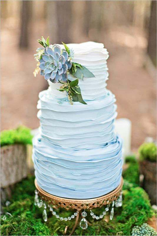 This blue wedding cake with buttercream and succulents looks gorgeous. That pale blue looks so beachy and fun!: