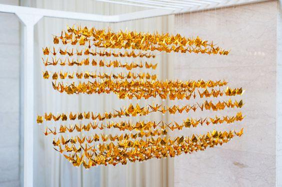 Gold foil cranes | Photo by Vivian Chen | Read more - http://www.100layercake.com/blog/?p=69758