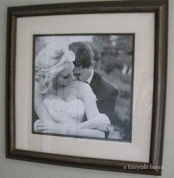 diy custom framing repurpose old framed artwork with blown up family photos printed in black