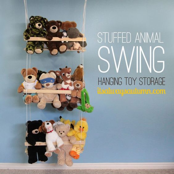 get all those stuffed animals and toys off the floor and organized on this super easy DIY stuffed animal swing.