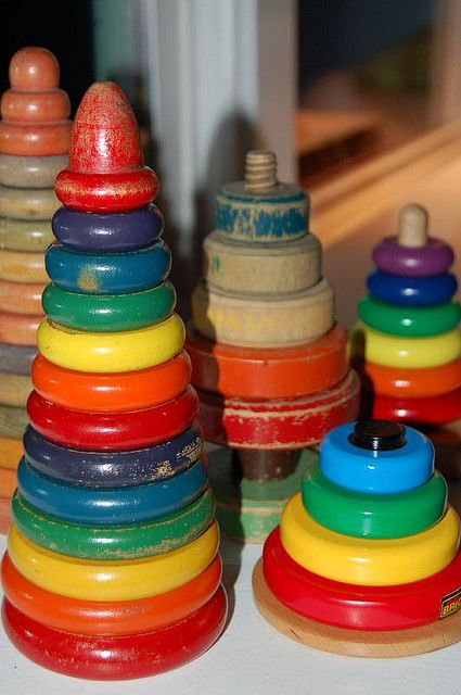 Collection of stacking toys, I remember these from when I was really little, and the spindle was wood. I thought the plastic was awesome smelling when I was that little.