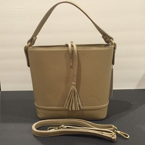 Tan Tassel Bucket Italian Leather Made in Italy This is a cutie! Each side has a tassel hanging down for a cute on trend effect. Cloth lining and includes shoulder strap. Size is 22x23x12 cm Bags Shoulder Bags