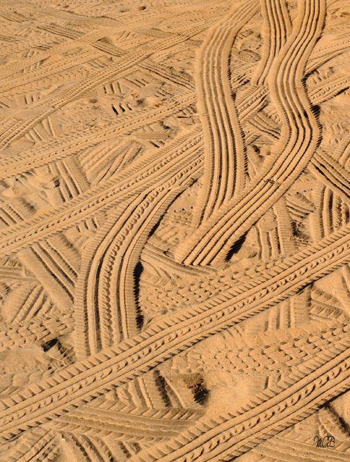 """Petjada antiecològica"", by Miquel Àngel Ballester Salas (I think). Tire treads on Figueral Beach, Balearic Islands (les Illes Balears)."