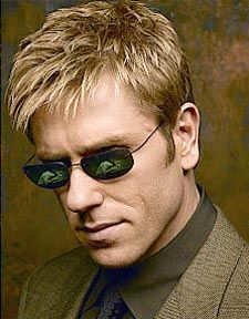 """Ron Eldard Ronald (born February 20, 1965) is an American actor born on Long Island, New York. After attending grade school in UT, Ron moved to Ridgewood, Queens to live with his sister Lana and her husband and attended JHS 93 annex in the 7th grade and then JHS 93 in the 8th and 9th grades. He worked at a local fast food restaurant called Chicken Galore where he often wore the """"Chicken Suit"""" mascot costume."""